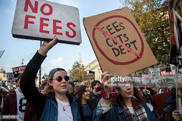 Protestors walk down The Strand during a march against student university fees on November 19 2014 in London England A coalition of student groups...