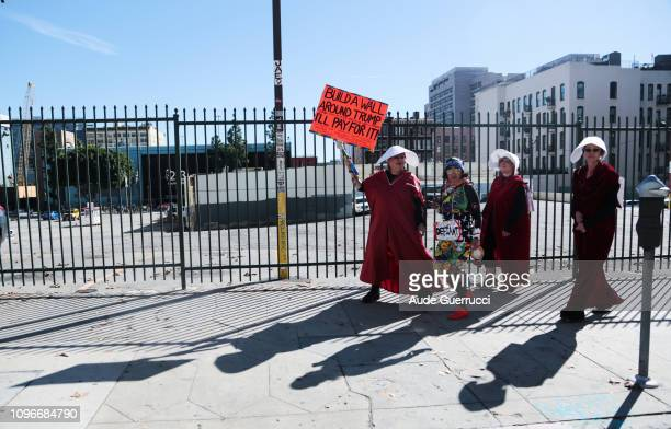 Protestors walk during the Third Annual Women's March LA in downtown Los Angeles California on January 19 2019 Thousands of participants attended the...