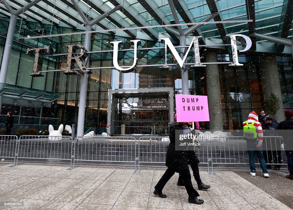 Protestors walk outside the front of the Trump International Tower & Hotel during the official opening on February 28, 2017 in Vancouver, Canada. The tower is the Trump Organization's first new international property since Donald Trump assumed the presidency.