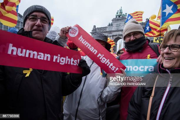 Protestors wave banners and Catalan 'Estelada' flags as they attend a proindependence demonstration in Brussels on December 7 2017 A sea of around...