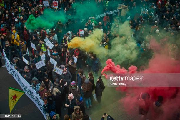 Protestors wave coloured flares during a rally near Place de Republique in support of the national strike in France one of the largest nationwide...