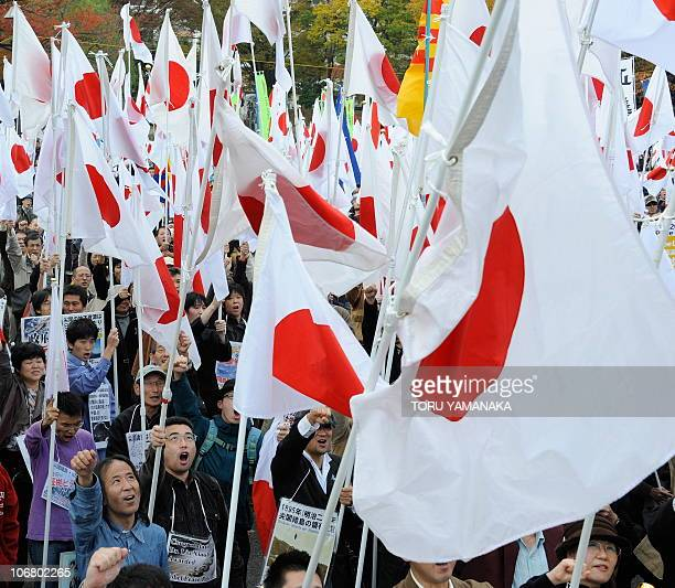 Protestors wave Japanese national flags during a rally denouncing China during the AsiaPacific Economic Cooperation in Yokohama on November 13 2010...