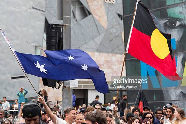 Protestors wave the Australian Flag with the Union Jack cut out and an Aboriginal Flag during a protest organized by Aboriginal rights activists on...