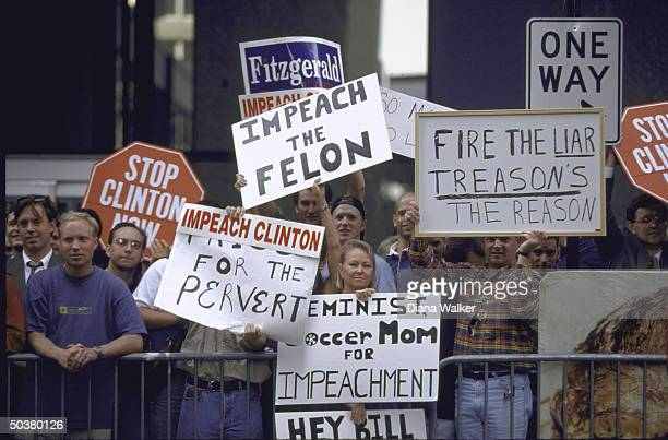 Protestors waving signs calling for Pres Bill Clinton's impeachment re his affair w White House intern Monica Lewinsky