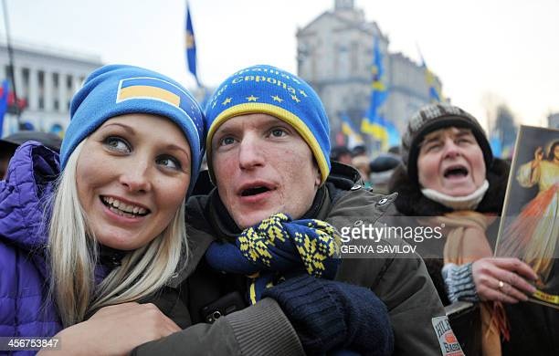 Protestors wear cap with Ukraine and Europa's flags during a mass rally of the opposition Independence Square in Kiev on December 15 2013 McCain told...