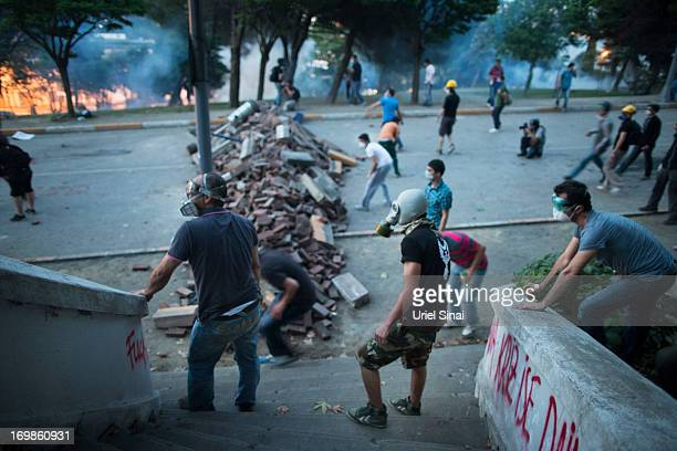 Protestors wear gas masks during clashes with Turkish police near Turkish prime minister Recep Tayyip Erdogan's office, between Taksim and Besiktas...