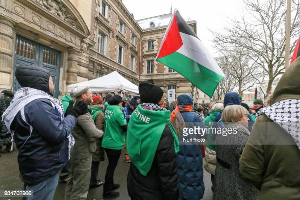 Protestors wear green Tshirts reading « Boycott Israel » during a demonstration on March 19 in front of the court of Versailles near Paris in support...