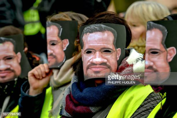 Protestors wear masks of former Elysee senior security officer Alexandre Benalla during a yellow vest antigovernment demonstration in Lille northern...