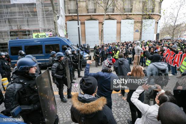 Protestors wearing a quotyellow vestquot face riot police officers as they demonstrate against rising costs of living in place de la Bastille in...
