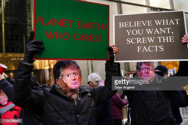 Protestors wearing Donald Trump masks rally outside of Trump Tower during an April Fools' Day protest against US President Donald Trump April 1 2019...