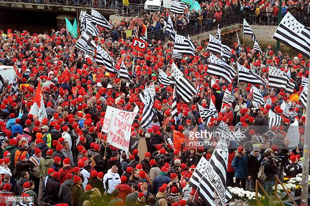 Protestors wearing red bonnets and waving flags of Brittany members of several economic sectors of the region gather for a demonstration against job...