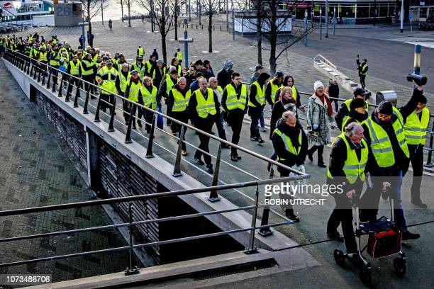 Protestors wearing yellow vests demonstrate on the Erasmusbrug in the centre of Rotterdam on December 15 2018 The socalled gilets jaunes protest...