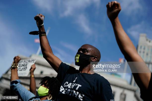 Protestors wears masks with the message I Still Can't Breathe during a vigil at Foley Square in New York on May 29 2020 against the death of George...