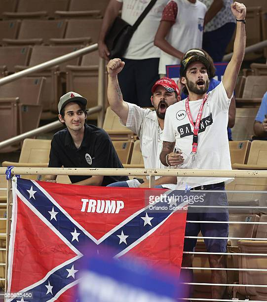 Protestors with a Confederate flag caused a stir when they were asked to remove the flag during a campaign rally for Republican presidential...