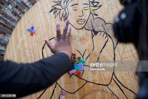 Protestors with Black Women's Blueprint create a mosaic while demonstrating outside the Montgomery County Courthouse during jury selection in the...