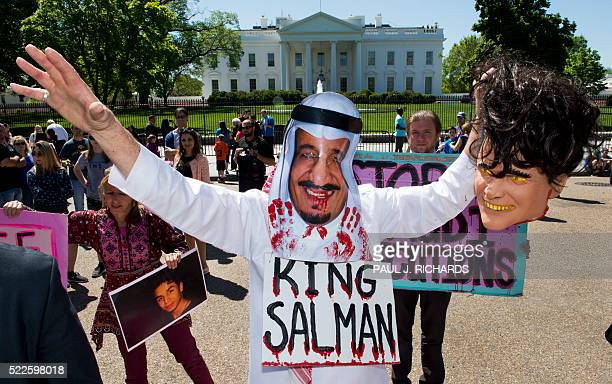 Protestors with Code Pink stage a mock beheading in front of the White House April 20 Washington DC to bring attention to the plight of three Saudi...