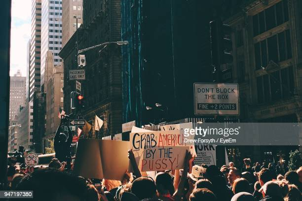 protestors with placards in city - demonstration stock pictures, royalty-free photos & images