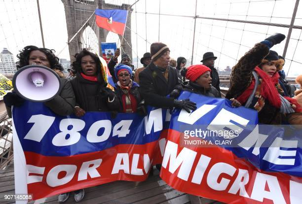 Protestors with the '1804 Movement for All Immigrants' march with the Haitian community and other immigrant forces across the Brooklyn Bridge January...