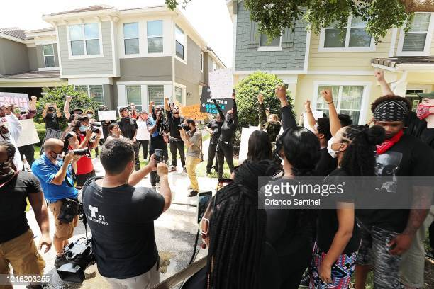 Protestors yell outside a home in Windermere, Florida, on Friday, May 29 The home is owned by Derek Chauvin, the Minneapolis police officer...