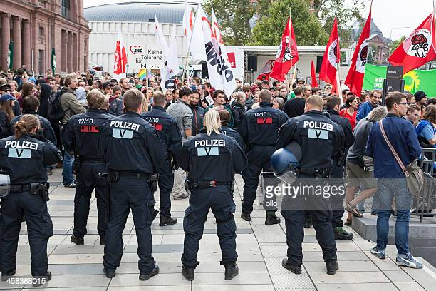 protests against npd election campaign - fascism stock pictures, royalty-free photos & images