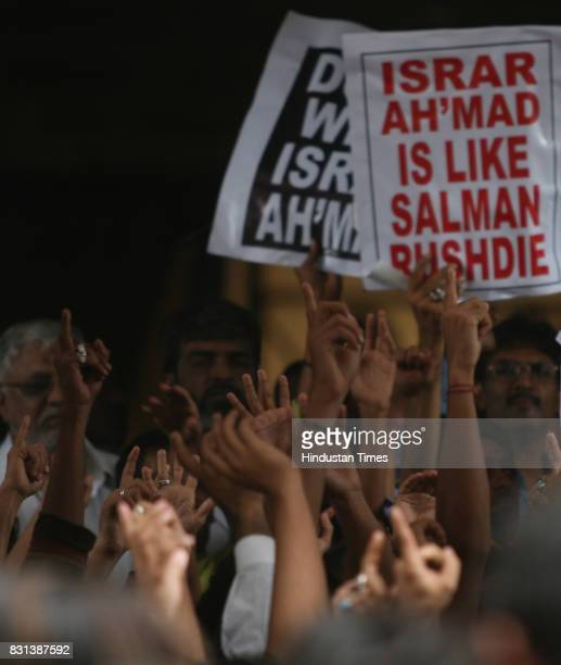 Protests and Demonstrations Placards People protest against Israr Ahmad for his blasphemous remark against Mushkil kuaha Maula E Kayenat Hazrat Ali...