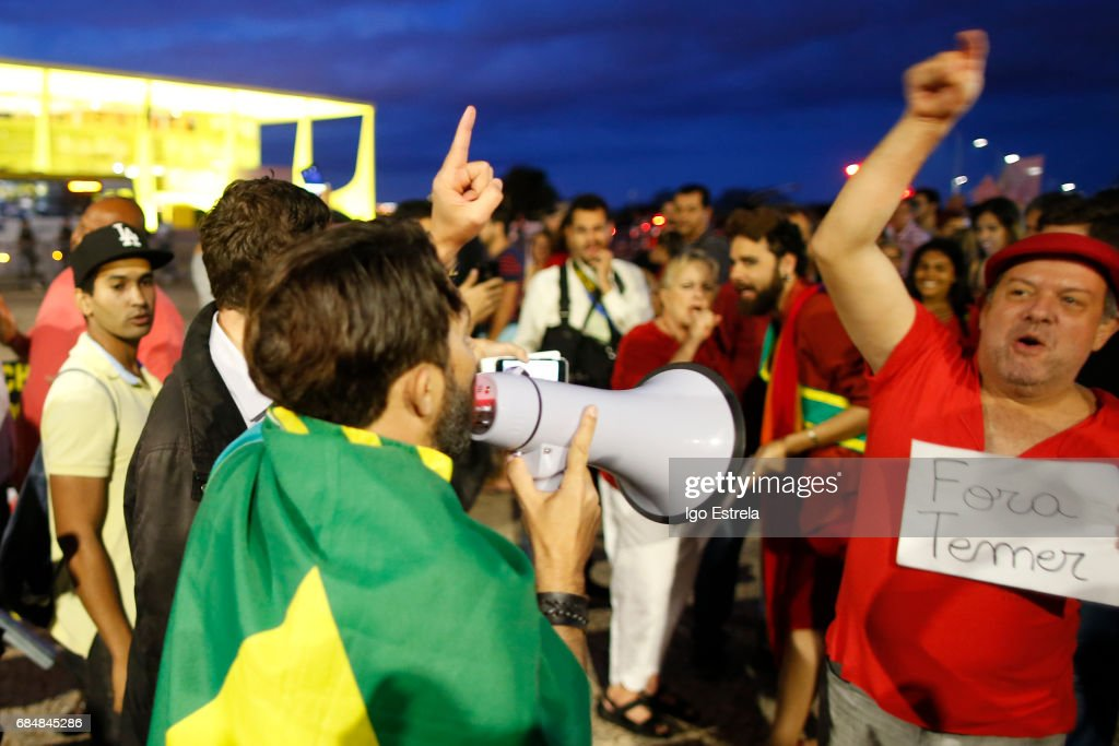 Protests erupt after embattled President Temer refuses to resign on May 18, 2017 in Brasilia, Brazil. A recording of Temer was released in which he allegedly condones bribery payments to Eduardo Cunha, the former President of the Chamber of Deputies. Cunha was involved in the 'Lava Jato' (Car Wash) corruption scandal and sentenced to 15 years in prison after being found guilty of corruption, money laundering and illegal money transfers abroad. With the release of the recording, the opposition has called for Temer's impeachment and new elections.