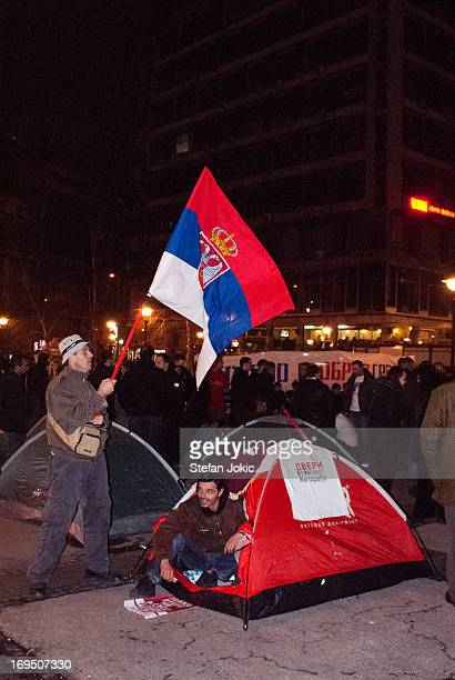 Protests in Belgrade. Guys camping on Republika Square