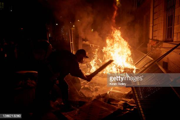 Protests turn violent outside the National Assembly during demonstrations against the French Government's proposed global security law bill on...