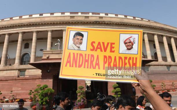 MP protests with party MPs demanding special status for the state of Andhra Pradesh during the Parliament Budget Session on March 20 2018 in New...
