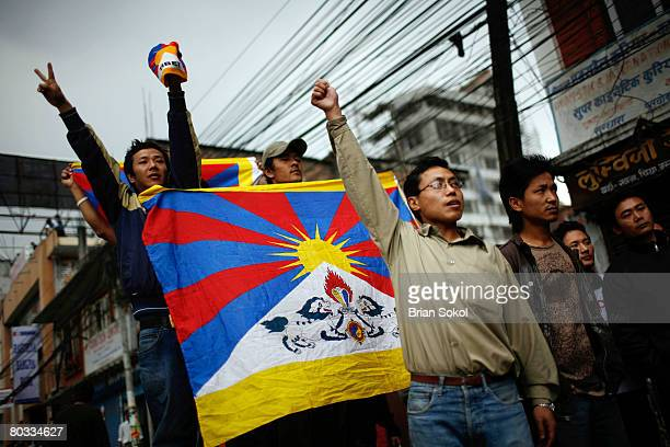 ProTibet activists hold a Tibetan flag during a Tibetan peace rally in front of the United Nations building on March 17 2008 in Kathmandu Nepal...