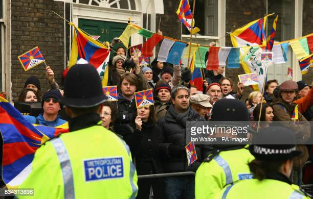 ProTibet demonstrators line the relay route of the Olympic Torch during its journey across London on its way to the lighting of the Olympic cauldron...