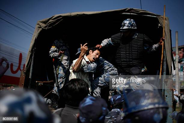 A proTibet supporter screams as he is hauled into a Nepali police vehicle by his hair during a peace protest organized by Amnesty International on...