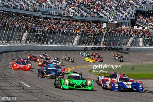 Prototype cars race into turn one at the start of the Rolex 24 at Daytona at Daytona International Speedway on January 30, 2016 in Daytona Beach,...