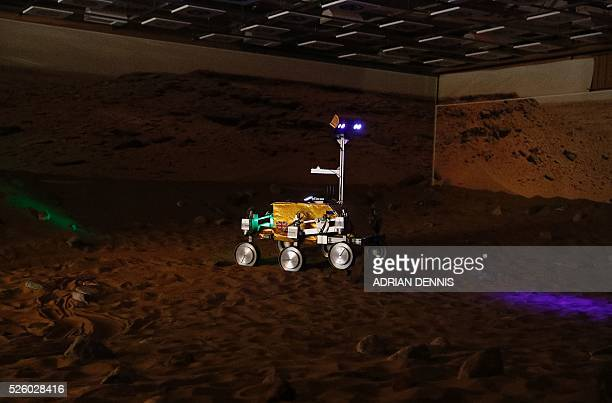 A prototype Mars rover in a simulated Mars environment is controlled by British astronaut Major Tim Peake at the Airbus Defence and Space company in...