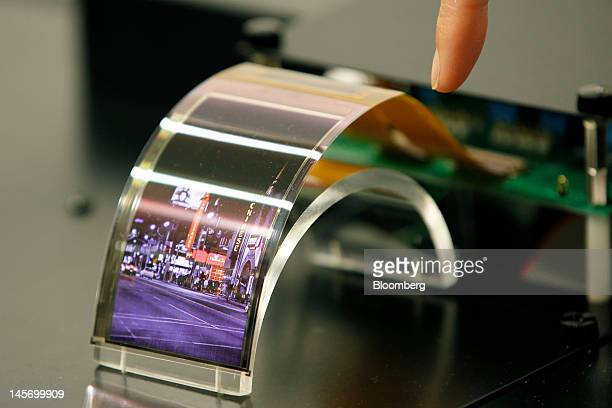 A prototype of a 34inch organic electroluminescent display based on the new indium gallium zinc oxide technology jointly developed by Sharp Corp and...