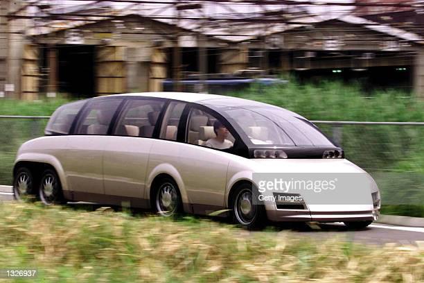 Prototype of an eightwheel electric limousine ''KAZ'' developed by Japan''s Keio University Professor Hiroshi Shimizu is taken out on a test course...