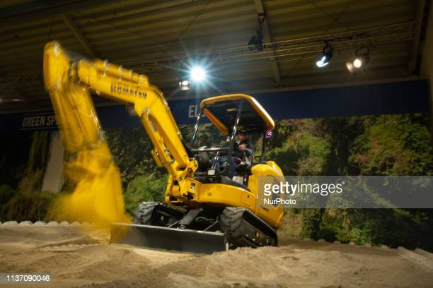 Prototype of an Electric Excavator of Komatsu in moving. The Bauma is the most important construction fair in the world and the biggest fair in...
