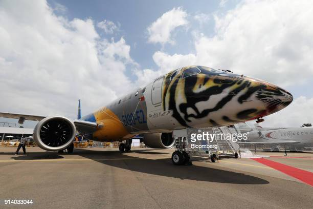 A prototype of an Embraer SA E190 E2 passenger aircraft stands on display during a media preview day at the Singapore Airshow held at the Changi...