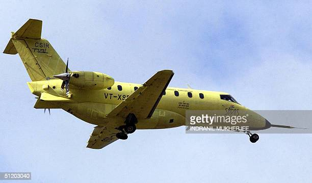 A prototype of India's first locallybuilt 14seater civilian aircraft flies 22 August 2004 after taking off from the tarmac of the Hindustan...