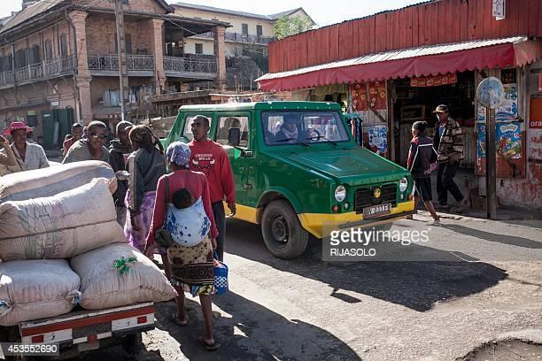 A prototype of the new Karenjy Mazana II car drives on a street of Fianarantsoa southern Madagascar on August 5 2014 AFP PHOTO/RIJASOLO