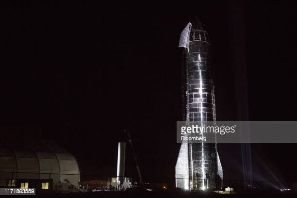 Prototype of the Space Exploration Technologies Corp. Starship launch vehicle stands during an event at the SpaceX launch facility in Cameron County,...