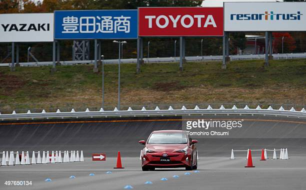 A prototype of Toyota Motor Corp's fourthgeneration Prius hybrid vehicle is driven during the test drive at the Fuji Speedway on November 12 2015 in...