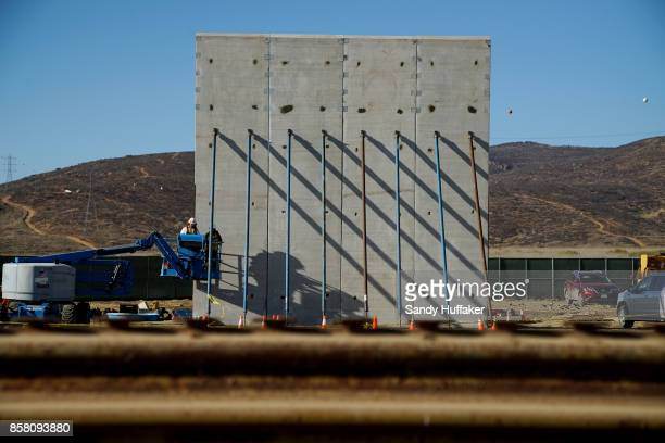 Prototype sections of a border wall between Mexico and the United States are under construction on October 5 2017 in Tijuana Mexico Prototypes of the...