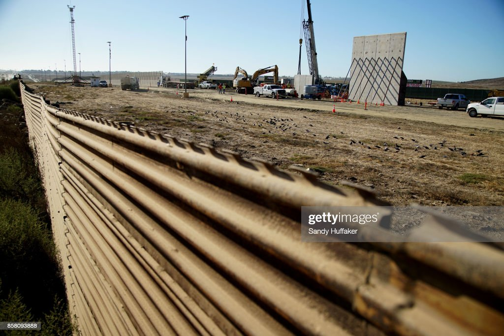 Prototype sections of a border wall between Mexico and the United States are under construction on October 5, 2017 in Tijuana, Mexico. Prototypes of the border wall propopsed by President Donald Trump are being built just north of the U.S.- Mexico border, where competitors who are hoping to gain approval to build the wall have until the first of next month to complete their work.
