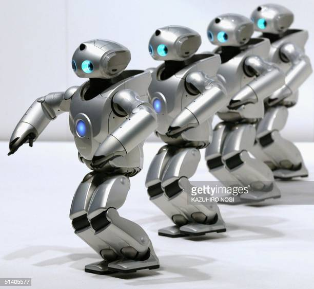 Prototype small biped entertainment robots SDR4X perform in a press preview in Tokyo 19 March 2002 SDR4X is a 60 centimeterhigh entertainment robot...