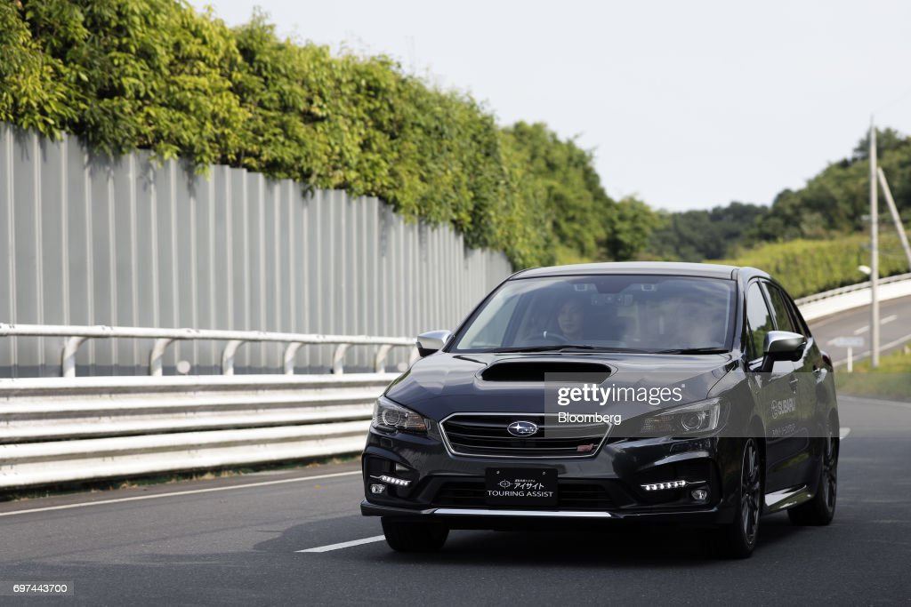 A prototype Subaru Corp. Levorg vehicle equipped with the company's EyeSight driving support system is driven during a test drive at Japan Automobile Research Institute's (JARI) Shirosato Test Center in Shirosato, Ibaraki, Japan, on Thursday, June 15, 2017. The EyeSight technology warns drivers when there is potential danger and can apply brakes. Photographer: Kiyoshi Ota/Bloomberg via Getty Images