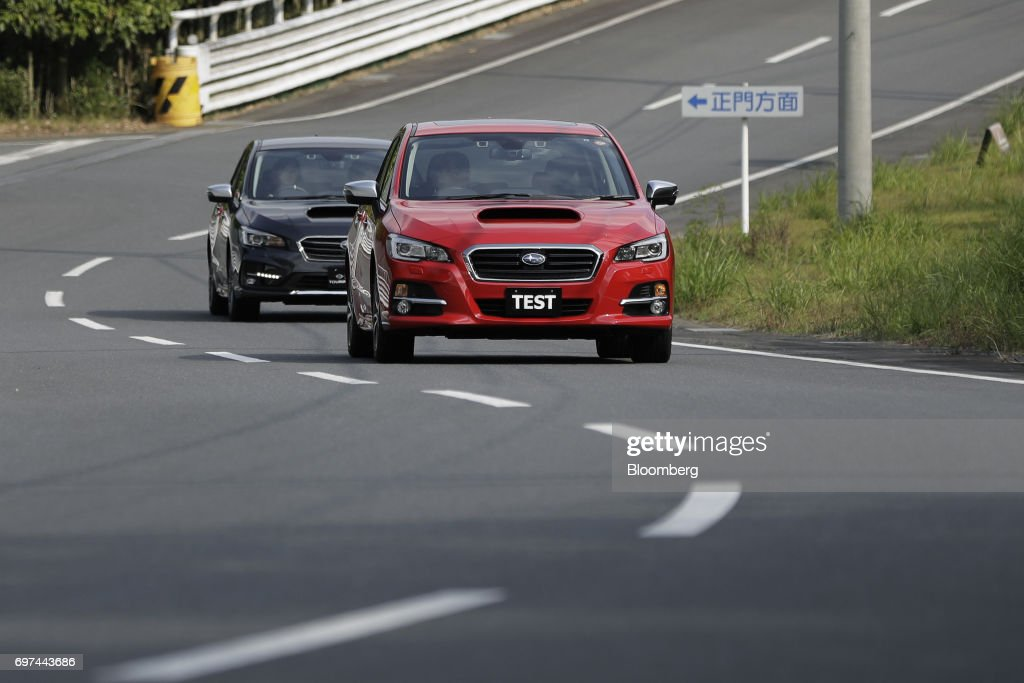 Prototype Subaru Corp. Levorg vehicles equipped with the company's EyeSight driving support system are driven during a test drive at Japan Automobile Research Institute's (JARI) Shirosato Test Center in Shirosato, Ibaraki, Japan, on Thursday, June 15, 2017. The EyeSight technology warns drivers when there is potential danger and can apply brakes. Photographer: Kiyoshi Ota/Bloomberg via Getty Images