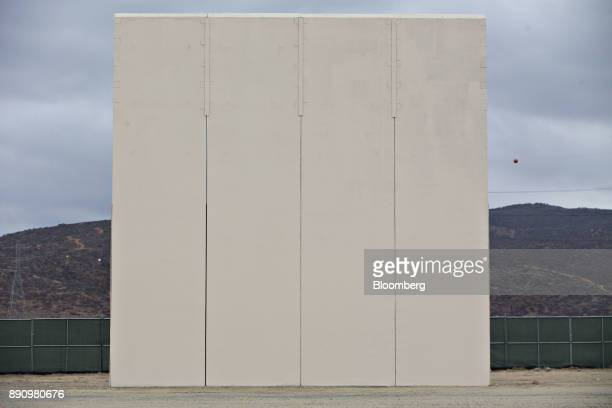 A prototype USMexico border wall stands in San Diego California US on Monday Oct 30 2017 President Donald Trump has directed the Department of...