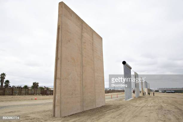 Prototype USMexico border walls stand in San Diego California US on Monday Oct 30 2017 President Donald Trump has directed the Department of Homeland...