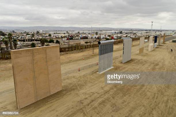 Prototype USMexico border walls stand in this aerial photograph taken over San Diego California US on Monday Oct 30 2017 President Donald Trump has...